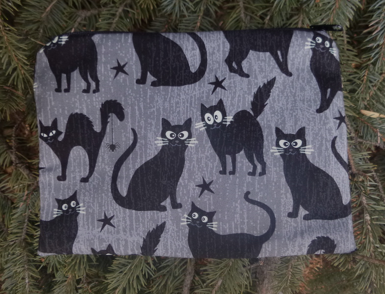 Glow in the dark cats zippered makeup bag