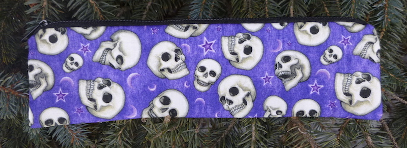 Pouch for paper and reusable straws with skulls